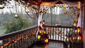 Softly lit ceremony on the Log Home balcony