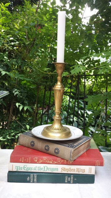 books and candlestick