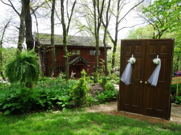 Located behind the log Home and adjacent to the Woodland Glen reception area