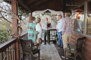 Extra small wedding, elopement, micro wedding on the Log Home Porch. LilyBlu Studios.