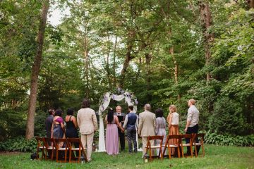 Ceremony in the woods at Storybrook Farm by JoPhoto