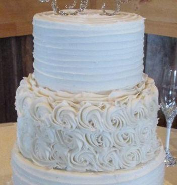 mixed frosting wedding cake by Petite Sweets